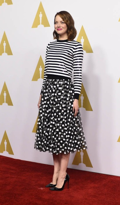 Emma Stone looking sweet in polka dots and stripes. Getty Images
